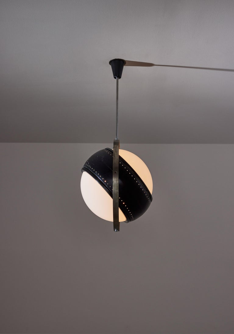Pendant by Oscar Torlasco. Designed and manufactured in Italy, circa 1950's. Nickel plated brass, painted metal, opaline glass diffuser. Original canopy, custom brass backplate. We recommend four E27 40w maximum bulbs. Bulbs provided as a one time