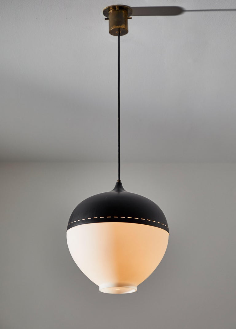 Pendant by Stilnovo. Manufactured in Italy, circa 1960s. Brushed satin glass diffuser and enameled armature. Rewired for U.S. junction boxes. Takes one E26 100 w maximum bulb.