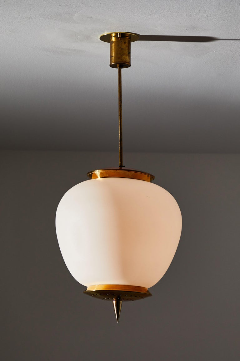 Pendant by Stilnovo. Designed and manufactured in Italy circa 1960s. Brushed satin glass and brass. Rewired for U.S. junction boxes. Takes one E26 100w maximum bulb.