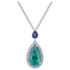 Pendant Drop Emerald Necklace in a Circle of Diamonds and Blue Sapphire Drop