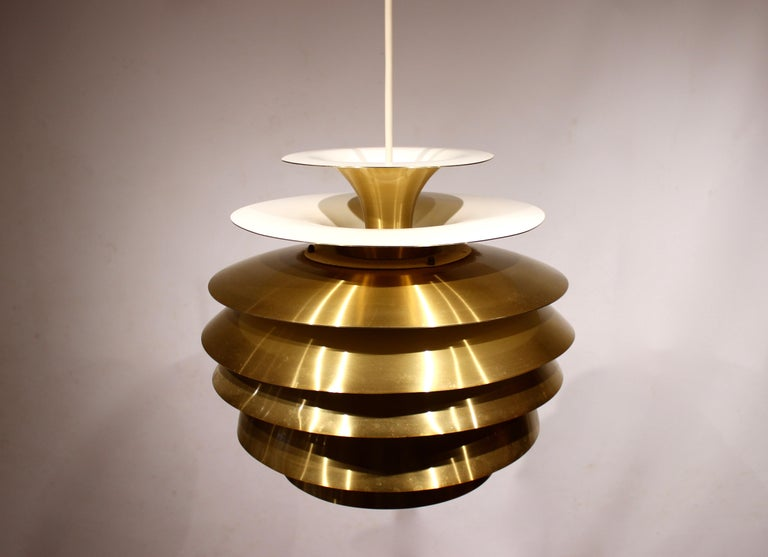 Pendant in brass by Bent Karlby from the 1960s. The lamp is in great vintage condition.