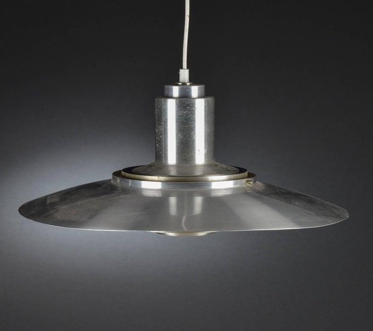 Pendant lamp by Preben Fabricius & Jørgen Kastholm for Nordisk Solar. Designed in 1963. Aluminium pendant.