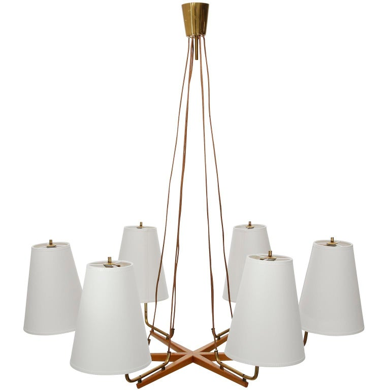 A large pendant lamp model no. 3652/6 'Holzstern' (England. wood star) by J.T. Kalmar, Austria. J.T. Kalmar designed the chandelier Holzstern already in the 1930s. The offered light was manufactured in midcentury, circa 1960. It is documented in the