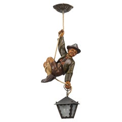 Pendant Light with Hand Carved Sculpture of Mountain Climber and a Lantern