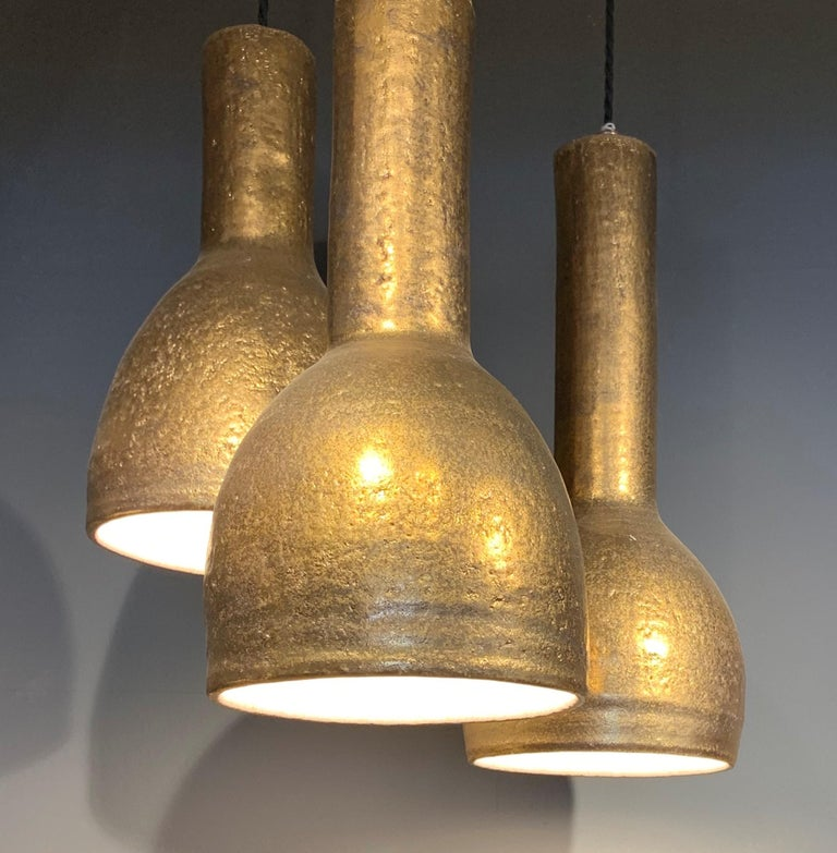 Pendant lights by Sotis Filippides stoneware (crank clay) and 24-carat gold with white interior, entirely handmade unique piece