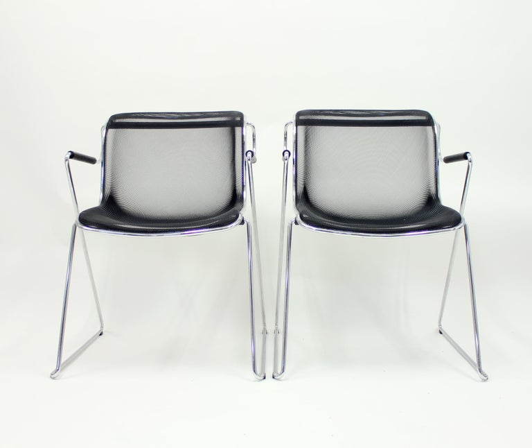Pair of Penelope chairs designed by Charles Pollock in 1982 for Italian manufacturer Castelli. Tubular steel frame, rubber armrests and steel mesh seat. Stackable. The pair is in a very good condition with hardly any ware.