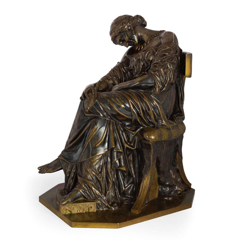 This is a precious little antique bronze sculpture by Pierre Jules Cavelier, originally exhibited at Salon in 1842 as Femme Grecque Edormie in plaster, was later exhibited in 1849 as a marble sculpture under the title of Penelope. It was cast almost