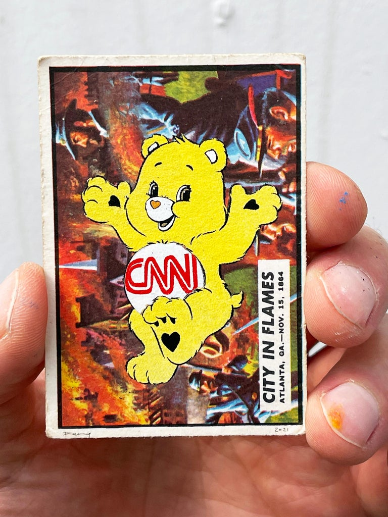 """Penny Figurative Painting - """"Care Bear Warfare - City in Flames"""" CNN (FRAMED) in black"""