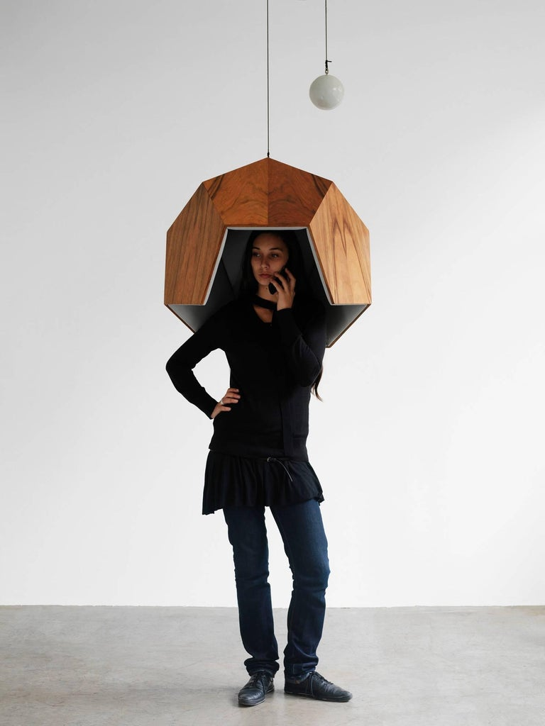 This object creates a subspace within a public area, making it possible to isolate oneself from the surrounding noise. It is reminiscent of a phone box, but it is an empty shell, because nowadays we carry our own phones. The interior is lined with