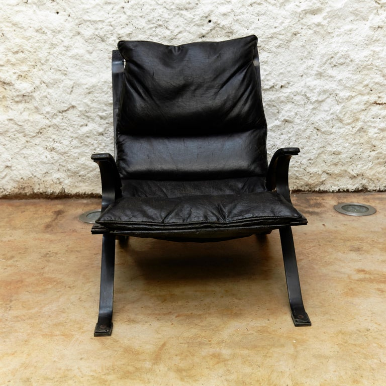 Lounge chair designed by Pep Bonet for Levesta manufactured in Spain, 1969.  Lacquered plated steel frame and original black leatherette.  In original condition, with minor wear consistent with age and use, preserving a beautiful patina. Some