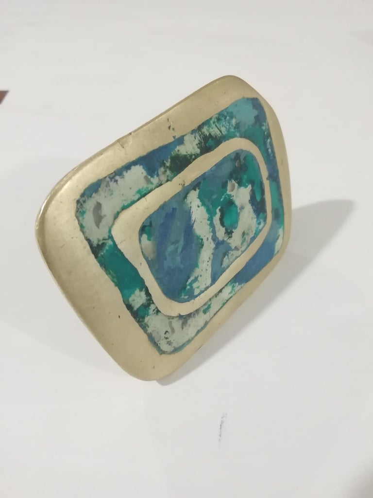Rare Mexican Mid-Century Modern bronze door or drawer pull by Mexican metalworker Pepe Mendoza. The organic design shows faux-turquoise inlays.  Sealed on back.