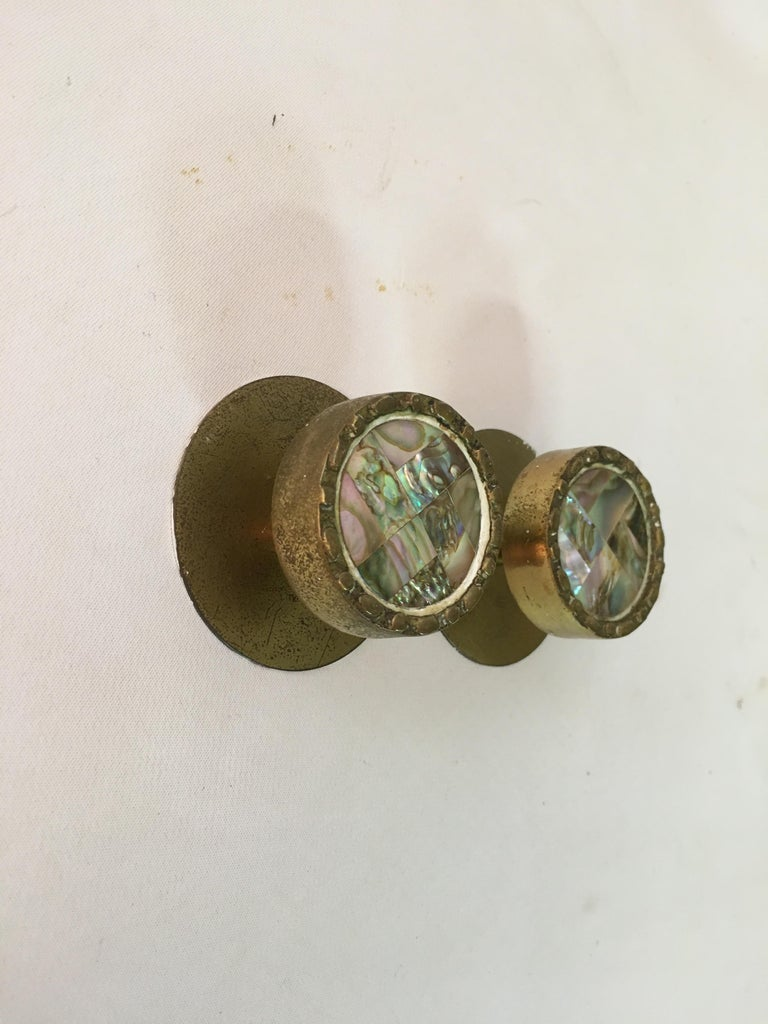 Pair of cast brass and Abalone hardware pulls in the style of Pepe Mendoza. Abalone mosaic inserts surrounded by brass. Signed on back with Japan and Mexico die stamps. circa 1960.    Round dimensions are 1.5