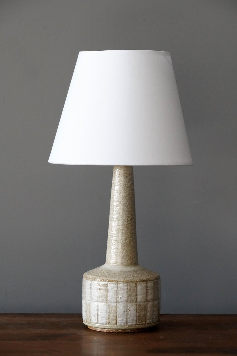 A table / desk lamp designed by husband and wife Per & Annelise Linneman-Schmidt. Handcast in firesand. Produced in their own Studio, named Palshus, in Sengeløse, Denmark. Signed.