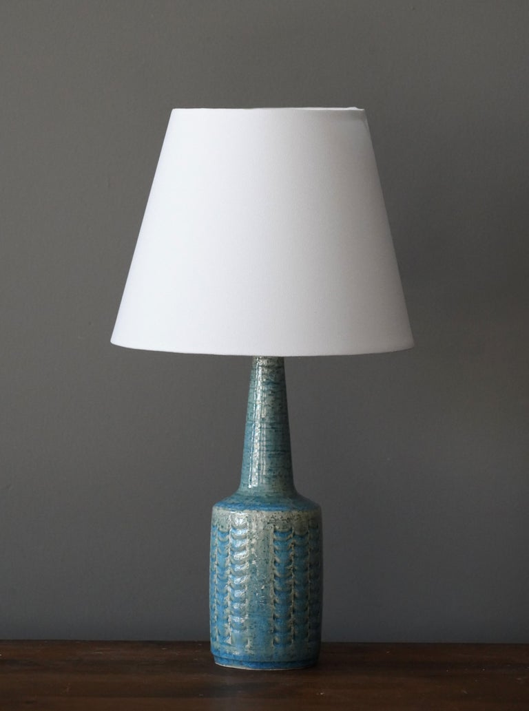 A table / desk lamp designed by husband and wife Per & Annelise Linneman-Schmidt. Handcast in firesand. Produced in their own Studio, named Palshus, in Sengeløse, Denmark. Signed.  The lampshade is attached for reference and not included in the