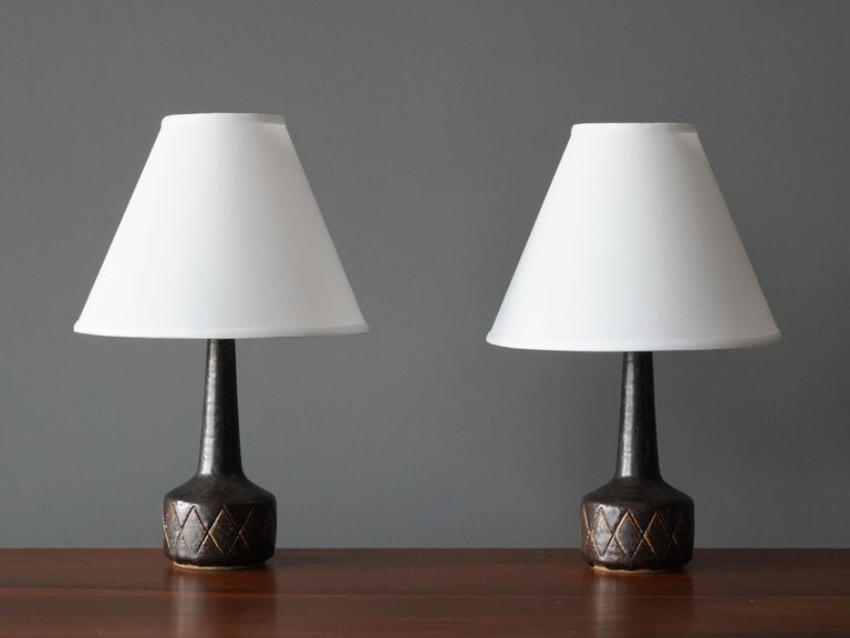 A pair of table / desk lamps designed by husband and wife Per & Annelise Linneman-Schmidt. Hand cast in fires and, each lamp with a unique glaze. Produced in their own Studio, named Palshus, in Sengeløse, Denmark. Signed  This pair of early