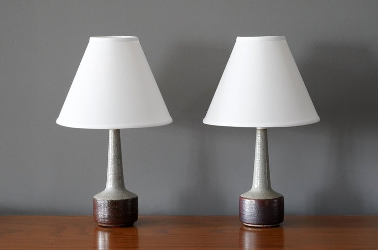 A pair of table / desk lamps designed by husband and wife Per & Annelise Linneman-Schmidt. Hand cast in fires and, each lamp with a unique glaze. Produced in their own Studio, named Palshus, in Sengeløse, Denmark. Signed  Other designers of the