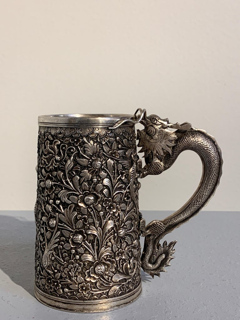 A heavy and well cast Chinese export silver tankard with a dragon handle, made of the Southeast Asian market, mid-late 19th century, China.