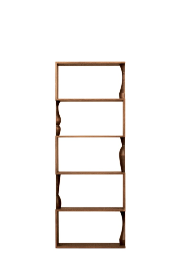 Contemporary style bookcase made of ash wood with wooden shelves, characterized by hand turned columns that can be coupled with another element, creating a complete turned vase