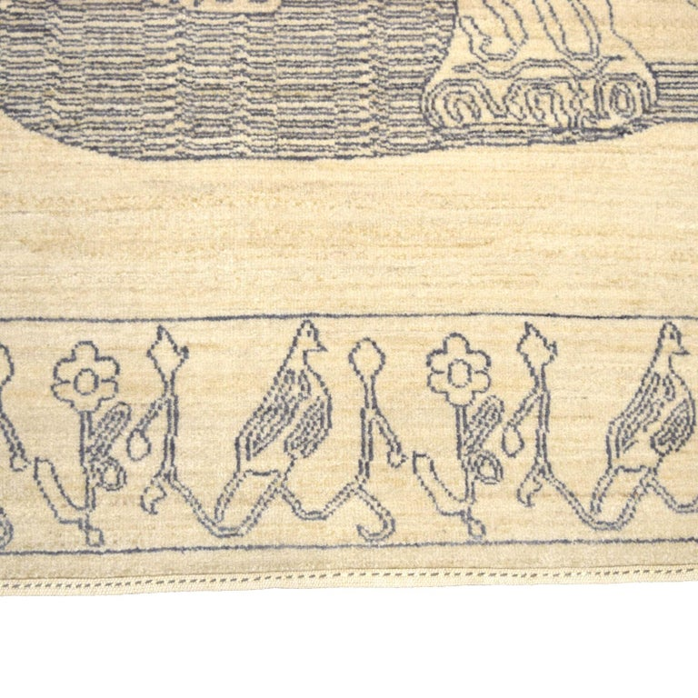 """Measuring 5'11"""" x 8'11"""", this Orley Shabahang carpet possesses a hand-knotted wool pile and a cotton warp and weft foundation. Upon a plush, so the design showcases a large squatting leopard with a simplistic and repetitive border. To create this"""