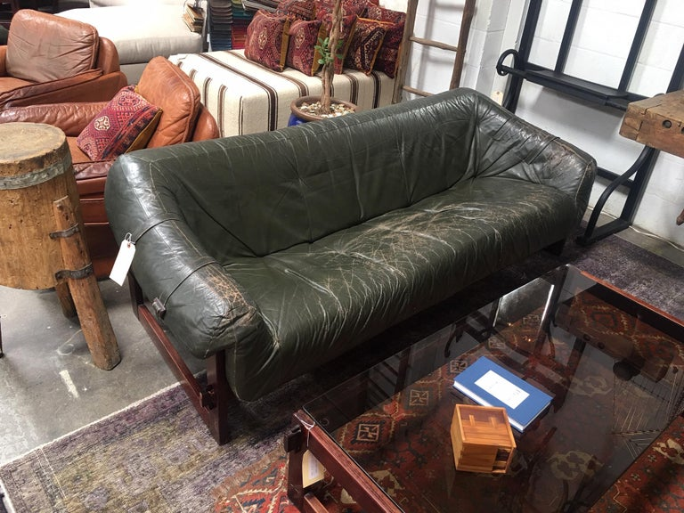 Beautiful Percival Lafer sofa in an emerald green leather. Leather shows patina consistent with the age of the piece.