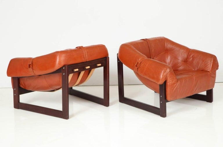 Percival Lafer lounge chairs model MP-091. Original caramel leather on Brazilian cherrywood frames. In good original condition, all completely original.