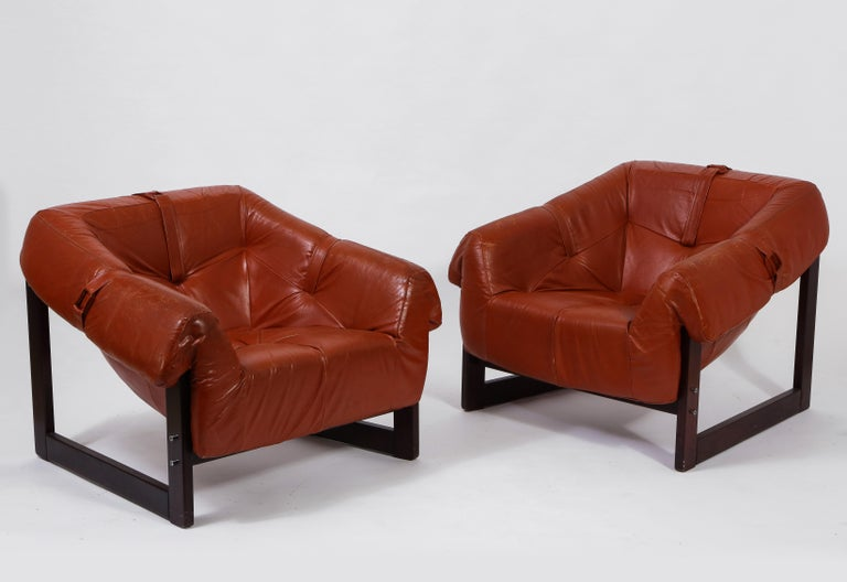 Made of Brazilian cherrywood and upholstered in caramel-colored leather, these chairs, Model MP-091 by Brazilian architect Percival Lafer, are of great comfort. Offered in original leather and finish. Label present on one chair.