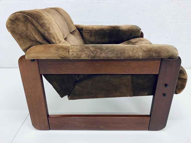 Brown patchwork suede leather over a rosewood frame lounge chair with arms by Percival Lafer, Brazil, 1970s.