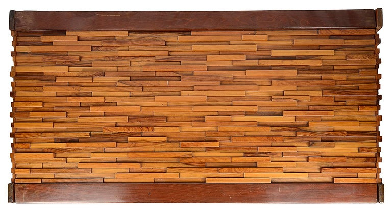 A very dramatic looking midcentury specimen wood coffee table, designed by Percival Lafer, dated 1960s. The top and side having these wonderful architectural inset woods. This table can complement many interior setting. Comes with a plate glass top.