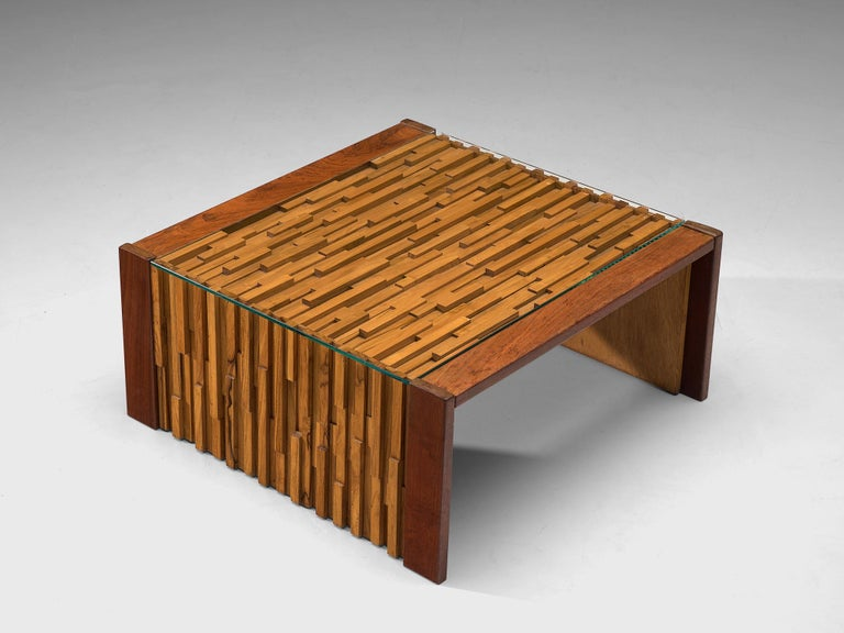 Percival Lafer, coffee table, Brazilian hardwood, mahogany, glass, Brazil, 1970s  Amazing cocktail table by Brazilian designer Percival Lafer. Highly sculptural design that is build up with pieces of Brazilian hardwood and mahogany. All the pieces