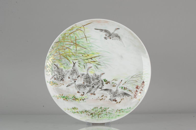 A very nicely decorated Japanese Porcelain plate, stunning colors. Marked at base.  17-12-19-1-16             Condition Overall condition perfect; size: 262 x 23mm Period 21st century 20th century.