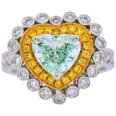 Perfect 53.23 Carat Heart Shape Natural Fancy Very Light Yellow-Green