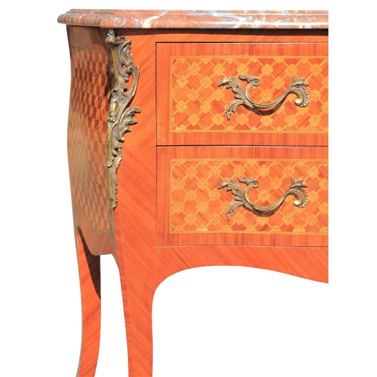 Beautiful Louis XV Style French parquetry ormolu mounted marble commode, early 20th century. Very nice condition.