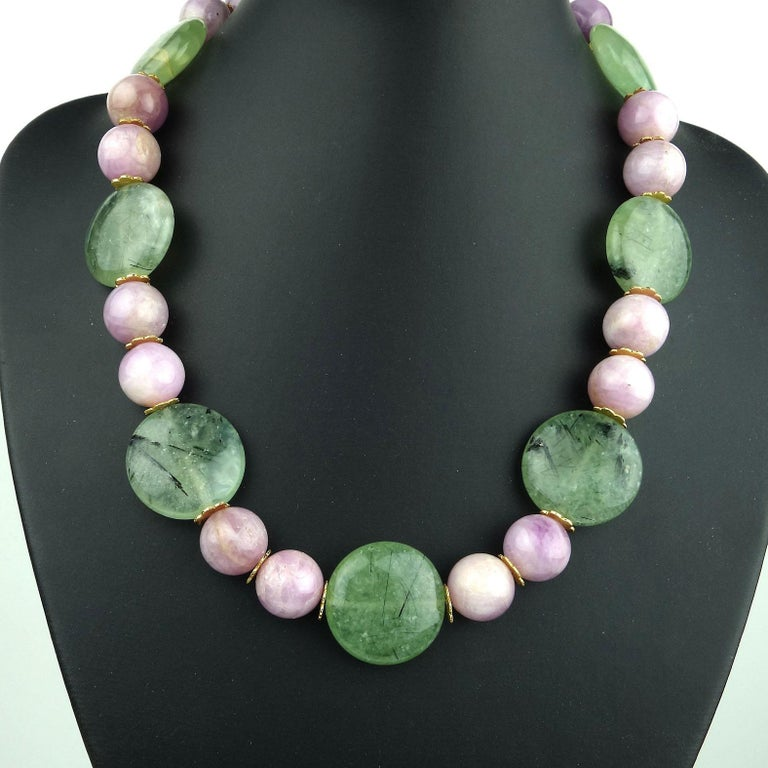 Glowing Summer necklace of Pink Kunzite 14 MM  beads and green Prehnite 25 MM discs. This extraordinary necklace is enhanced with gold tone fluted spacers and a vermeil hook closure.  The beautiful Brazilian Prehnite comes from one of our favorite
