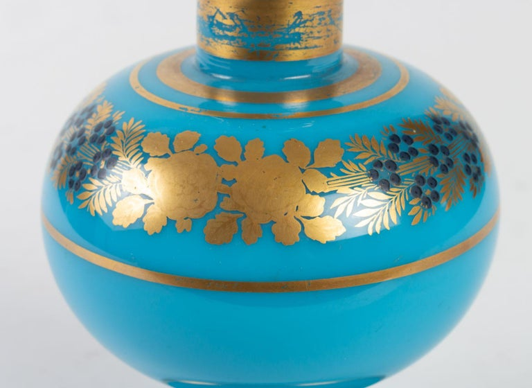 Perfume bottle in turquoise blue opaline, gilded and enamelled, by Desvignes Design, Charles X Period, 1830-1840  Measures: H 17 cm, D 10 cm.