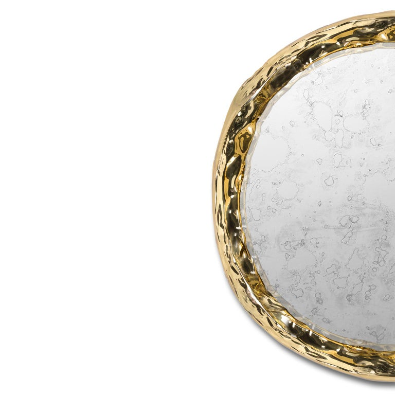 """1. Product description:  The """"Pergamo"""" mirror is made of polished hammered brass framing an aged mirror with the purpose of giving this piece an old look, full of stories to tell just like a parchment. In the end, the brass is protected with a"""