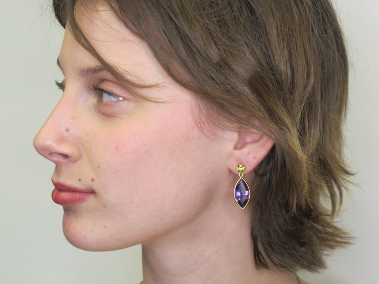 The interplay of  colors and shapes of gemstones are what make these earrings unique. Two round, bright