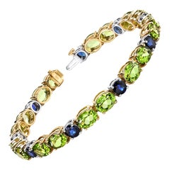 Peridot and Blue Sapphire, Yellow, White Gold Tennis Bracelet, 24.20 Cts. t.w.