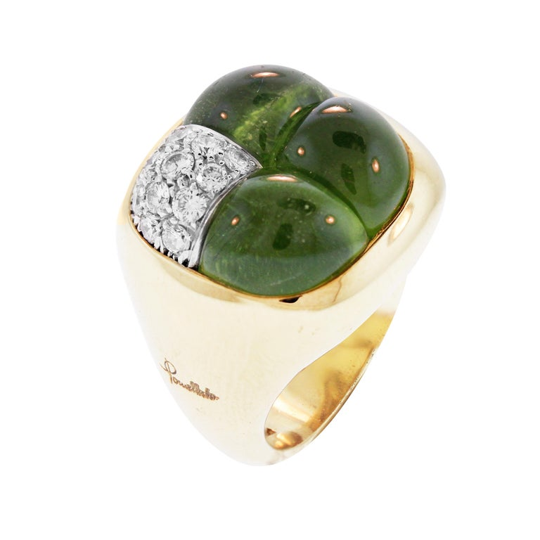 IF YOU ARE REALLY INTERESTED, CONTACT US WITH ANY REASONABLE OFFER. WE WILL TRY OUR BEST TO MAKE YOU HAPPY!  18K Yellow Gold and Diamond Ring with Three Special-cut Peridot by Pomellato  0.50 carat G color, VS clarity diamonds  Face of the ring