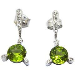 Peridot Diamonds and 18 Karat White Gold Dangle Earrings
