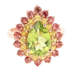 4.76 Carat Peridot Red and Yellow Sapphire 14 Karat Rose Gold Ring