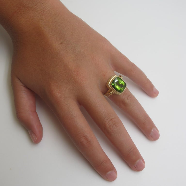 It's so easy being green. Wear this citron colored Peridot with anything. The Peridot (13.30x11.20mm/9.24cts) is clean and brilliant, set in a handmade ring with classical details. The ring is size 9.  Handmade by our jewelers in Los Angeles.