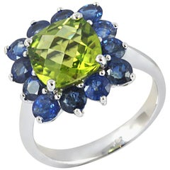 Peridot with Blue Sapphire Ring set in 18 Karat White Gold Settings