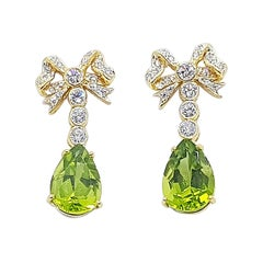 Peridot with Diamond Bow Earrings Set in 18 Karat Gold Settings