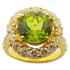 Peridot with Yellow Diamond Ring Set in 18 Karat Gold Settings