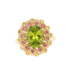 4.51 Carat Peridot Yellow and Red Sapphire 14 Karat Yellow Gold Cocktail Ring