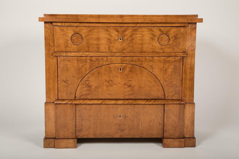A quilted birch chest of drawer with interior constructed out of pine. This minimal approach to 1830s furniture pairs very well with the contemporary design vernacular.