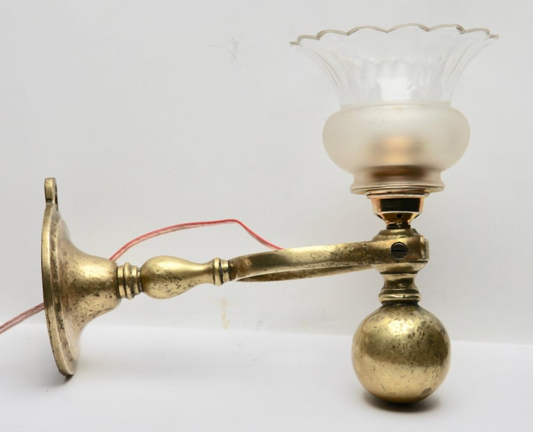 Faceted Period Brass Ship's Wall Lamp with Weighted Gimble and Milk-Glass Lampshade For Sale