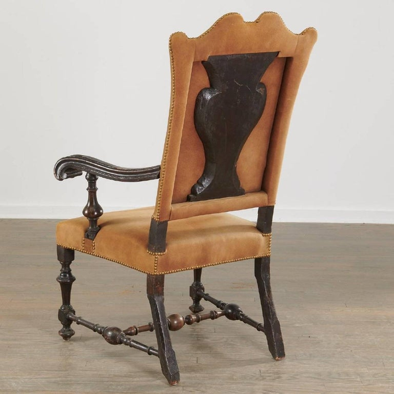 Period Dutch walnut armchair of the late 17th century  --Beautifully turned stretchers. Arched back. Scrolled arms. Great patina, Large size --Now in fitting suede leather.