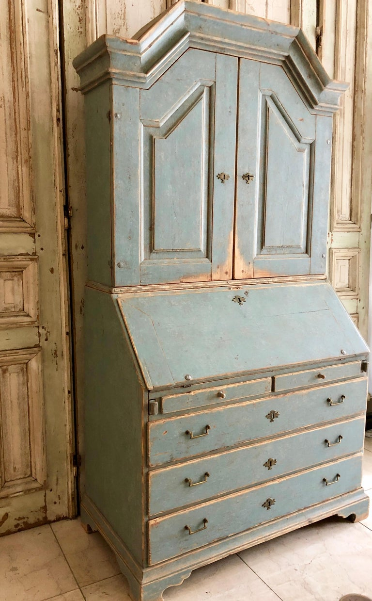 A very fine example of early 19th century secretaire cabinet of Gustavian period with a high arching pediment cornice and panelled doors with date indicading that this cabinet was given later as a wedding gift 1840. The fall front desk with