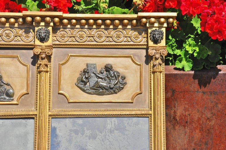 Original and magnificent English Regency period overmantel mirror  --Original mirrors --Lion heads, Corinthian columns, and neoclassical frieze --Middle frieze depicts the nine Muses: (Left to right) Polymnia, Calliope, Clio, Tersichore, Erato,